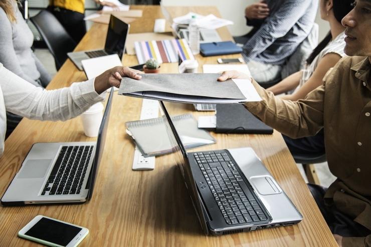 action group desk laptops folders work